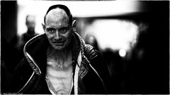 Walk a Crooked Mile (Neil. Moralee) Tags: neilmoralee neilmoraleetaunton film noir dark moody danger lurking man face wicked bad evil crime fear portrait candid street taunton somerset neil moralee nikon d7200 black white bw bandw blackandwhite sinister frightening hard balding hair short contrast chest bare stare dramatic style gollum harsh grim wild