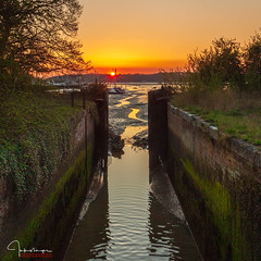 Old Lock Sunset II (inkslinger15) Tags: blue boats bullrushes chichester estuary houseboats jetty loch marina sky suset water canal gates sunset red orange glow footbridge