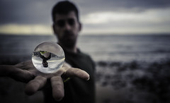 Crystal ball over the hand on the beach (JuanraRBB) Tags: andalucia beach beard beautiful black bracelet calm calmness caucasian clouds cloudy comely crystalball day depth face hair hand handsome horizon lifestyle man mediterranean nature nice ocean outdoor over pretty quiet quietness relax sand sea seashore season seasonal sky spring springtime stones storm summer sunny sunset texture tranquility upsidedown water wave way weather whiskers young