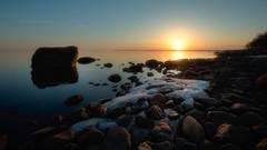 Halttula sunset (last snow) (M.T.L Photography) Tags: halttula sunset water sea rocks trees sky snow calm tyyni vesi meri auringonlasku mtlphotography mikkoleinonencom