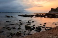 Sunset in St Jean de Luz (edouardfourcade) Tags: basque france pays saintjean color calm water landscape seascape lieux ocean sunset rocks sea rock sky bay beach shore sand plage mer ciel jaune