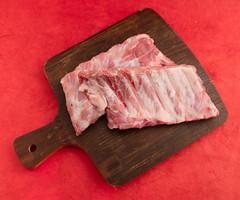 Spare ribs. (annick vanderschelden) Tags: spareribs pork meat raw chop bone ingredient sideribs porkribs cuisine food cooking platter lard wooden wood brown belgium