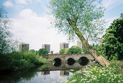 lsuc - bridge over the tame (johnnytakespictures) Tags: lomo lomography lomographycn400 film analogue 35mm disposable camera simpleuse colour tamworth staffordshire river canal stream water nature natural reflect reflecting apartments towers tower block blocks apartment 4 four bridge crossing architecture arch