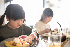Happy little sisters eating pancake in cafe (Apricot Cafe) Tags: img87251 asia asianandindianethnicities cafe healthylifestyle japan japaneseethnicity tamronsp35mmf18divcusdmodelf012 adolescence backlit bright candid carefree casualclothing charming cheerful chibaprefecture child childhood colorimage copyspace day eating elementarystudent enjoyment family foodanddrink fruit girls happiness indoors innocence juice leisureactivity lifestyles longhair lunch pancake people photography preschoolage realpeople restaurant satisfaction schoolchildren selectivefocus sister smiling springtime straighthair sunlight sustainablelifestyle toddler togetherness twopeople waistup weekendactivities ichiharashi chibaken jp