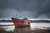 The Sabrina (John Holmes (DAJH51)) Tags: abandonded beached clouds fishingboat lowtide rain red redhull seaweed wreck