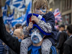 Saltire (Leanne Boulton) Tags: people urban street candid portrait portraiture streetphotography candidstreetphotography candidportrait streetportrait eyecontact candideyecontact streetlife man male girl female dad father child eyes face facepaint look emotion feeling expression scottish saltire flag rally independence march protest event crowd blue family tone texture detail depthoffield bokeh naturallight outdoor light shade city scene human life living humanity society culture lifestyle canon canon5d 5dmkiii 70mm ef2470mmf28liiusm color colour glasgow scotland uk reportage