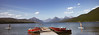 Lake McDonald Paddle Boarding (JZ in ATL) Tags: glacier national park paddleboarding lake bathing suit speedboats pier mountains vista water reflection red motorboats