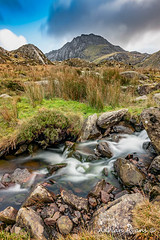 Tryfan Snowdonia National Park (Adrian Evans Photography) Tags: tryfanface rock cwmidwal snowdonia landscape face idwal uk landmark mountains water outdoor tryfanmountain wales llynidwal clouds ogwenvalley longexposure creek valley rapids waterfall carneddaumountains adrianevans northwales tryfan sky snow riverside river ogwen glyderaumountains