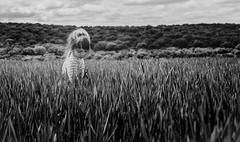Feelings (Bai R.) Tags: springtime child childhood girl feel feeling grass green bw