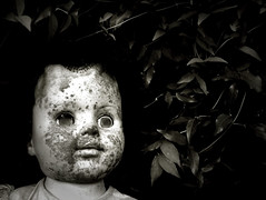Smallpox the mildewed doll in the cat's claw vine (opticwaste) Tags: antique spooky haunted doll crackle crackled gothic weird neworleans eyes creepy vine olympus 2020