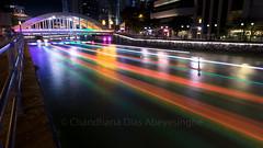 Rainbow Bridge (CJ Dias Abeyesinghe) Tags: lights elgin ef1635mmf4lisusm bridge longexposure water city singapore cityscape colouful streaks night clarkequay