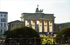 Meeting an icon (angelsgermain) Tags: gate monument columns neoclassical prussian quadriga sculpture pediment people square pariserplatz buildings fence bikes afternoon sun light spring plants brandenburgertor brandenburggate mitte berlin deutschland germany