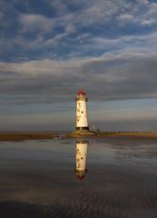 Talacre Lighthouse (Simon Wootton) Tags: talacrelighthouse lighthouse structure beach sea reflection goldenhour bluesky clouds