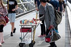 Souvenirs (Geoff Henson) Tags: vendor salesman people man trolley bag bridge souvenirs