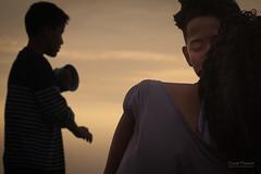 First kiss (DavidPasserat) Tags: kiss people southamerica romance streetportrait street flirt dusk sunset shadows couple teens firstlove firstkiss hollidays fishing