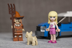 Stephanie and her dog is keeping an eye on that Scarecrow (N.the.Kudzu) Tags: tabletop lego minifigures scarecrow car dog stephanie primelens canondslr manualfocus lensbabyvelvet56