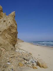 Pikachu Bluff (Paul Henegan) Tags: atlanticocean montaukny beach bluff clouds coast sand shore sky stones surf fb pikachu
