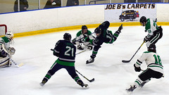 """Flyin' to the net"" (R.A. Killmer) Tags: sru ice hockey game competition slippery rock university shot net goalie playoff acha"