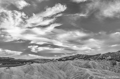 Death Valley National Park - Zabriskie Sky_B&W_21029 (www.karltonhuberphotography.com) Tags: 2014 adventure afternoon afternoonlight bw basalt beautiful blackandwhite breathtaking california claystone clouds colors deathvalley deathvalleynationalpark depthoffield drama expansive exploring geologichistory geology karltonhuber landscape landscapephotography leadinglines lines mountainpeaks mountains nationalpark naturalworld nature naturephotography nikkor1735mm nikond7000 outdoors patterns peaceful relaxing rocks siltstone sky texture veins view weather wideangle zabriskiepoint