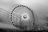 La noria - The Ferris wheel (ricardocarmonafdez) Tags: sevilla feria fair wheel fairwheel structure urbanscape ciudad city atardecer storm cielo cloudedsky graysky twilight dusk lighting effect edition processing monocromo monochrome blackandwhite bw bn 60d 1785isusm canon