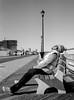 Catching Some Rays (Dalliance with Light (Andy Farmer)) Tags: jersey street beach ocean monochrome boardwalk asburypark leicam6 ddxdeveloper14 nj bw ultrafinextreme100 elmaritm28mm film shore newjersey unitedstates us