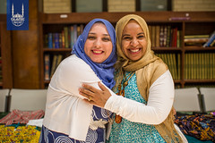 Two graduates celebrate after completing a class that taught them to sew and also gave them another family.