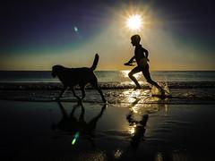 Kid & His Best Friend (Maarten Baars) Tags: beach dog dogs pet pets child children kid kids sunset evening panasonic1235mmf28 panasonicgx80 streetphoto streetphotography mirrorless microfourthirds micro43 streetview streetstyle streetlife