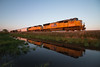Reflection at Day's End (Jake Branson) Tags: train railroad locomotive union pacific up emd sd70m villa grove il illinois midwest reflection