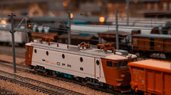Orange Toys (WT_fan06) Tags: model railway cfr ea le5100 tracks rails wires railyard brown red orange blur bokeh light beautiful artistic artsy aesthetic depth field focus point focal aperture contrast nikon d3400 dslr photography 7dwf flickr readyfortheday coth5 yellow blue aqua toys h0 scale miniature mini makro macro world old bulrry fuzzy background engine locomotive electric romania bucharest asea zug bahn weiss rot wagen alt rumanien bukarest 060 classic style