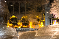Aperol Bar at Milan's Piazza del Duomo on a rainy evening (Phototravelography) Tags: aperol aperolspritz italia italien italy lombardei lombardia lombardy mailand milano piazzadelduomo alcohol aperitif aperitivo city drink floor milan ombrellone orange parasol pavement red reflection terrace terrazza fccnightphotos rain water wet ngc