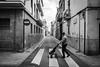 Down the road (Shane Jones) Tags: road street zebra houses buildings city figures spain panasonic lumixlx100