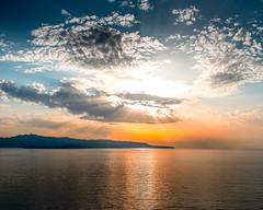 Sicily  Sunset (Daveyal_photostream) Tags: sicily italy igitaly sunset sunsetting sun sunlight sunray clouds bluesky ocean reflection nikon nikor nature colorful d600 meandmygear mygearandme mycamerabag motion movement beautiful beauty mountains seascape sky water serene mountain