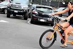 Bicycle crossing (thomasgorman1) Tags: cars parking crossing woman cyclist outdoors beach hawaii nikon street candid public streetphotos streetshots kahaluu island kona