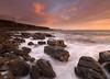 Parton stormy sunset (Alf Branch) Tags: sea seaside seawaves seascape rocks rough roughsea irishsea parton partonbeach westcumbria water waves alfbranch olympus omd olympusomdem5mkii zuiko zuiko918mmf456ed