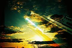 Lomo – UK sunset vs Dubai skyline (lomomowlem) Tags: 35mm analogue crossprocess colourstreambrighton clouds doubleexposure expiredfilm kodakelitechrome lomo lomography lca lofi multipleexposure sunset skyscraper xpro xprocess highrise