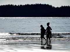 A backlit fun at the beach series (+7) (peggyhr) Tags: peggyhr silhouettes figures beach ocean mountain trees waves backlit mackenziebeach reflections dsc00659a tofino bc canada sparkling infinitexposurel1 visionaryartsgallerylevel1 thegalaxy infinitexposurel2 infinitexposurel3