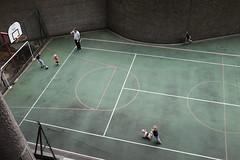 Football (Gary Kinsman) Tags: fujix100t fujifilmx100t london 2018 candid streetphotography cityoflondon ec2 barbican streetlife people person sport playing kids children dad father pitch green football