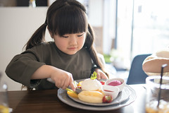 Happy little girl eating pancake in cafe (Apricot Cafe) Tags: img87236 asia asianandindianethnicities cafe healthylifestyle japan japaneseethnicity tamronsp35mmf18divcusdmodelf012 adolescence backlit candid carefree casualclothing charming cheerful chibaprefecture child childhood colorimage copyspace day eating enjoyment foodanddrink fruit girls happiness icecream indoors innocence knife leisureactivity lifestyles lunch oneperson pancake people photography preschoolage realpeople restaurant satisfaction smiling springtime strawberry sunlight sustainablelifestyle toddler waistup weekendactivities ichiharashi chibaken jp