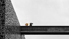 Orange Umbrella (Leipzig_trifft_Wien) Tags: marseille provencealpescôtedazur frankreich fr street streetphoto rain rainy building bridge city urban colorkey