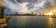 Sunset over the Chicago skyline (Kevin Povenz Thanks for all the views and comments) Tags: 2016 june kevinpovenz illinios chicago lakemichigan windycity water sun sunset evening rain rainy storm stormy dusk pier pierpark canon7dmarkii sigma buildings pano panoramic