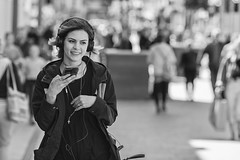 Happy with what she's hearing (Frank Fullard) Tags: frankfullard fullard candid street portrait lady woman happy listen mobile phone likes smile smiling dublin irish ireland crowd people ring nosering cross device monochrome blackandwhite noir blanc stylish joy