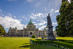 British Columbia parliament building with Queen Victoria in front of it (Mantas Volungevicius) Tags: british columbia canada capital building queen victoria summer bc grass sky clouds parliament goverment politics economy finance travel tourism city cityscape nkon d7000 tokina wide angle flowers vancouver island downtown