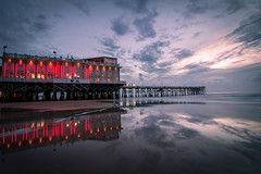 Reflective (tshabazzphotography) Tags: sunrise beach bluehour sand clouds pier daytonabeach florida colorful color restaurant explore outdoors canon wideangle longexposure water seascape landscape ocean atlanticocean sky sunset seaside magenta lowtide low tide shallow orangeandblue