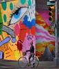 Got my eye on you (ginoNYC) Tags: grafitti mural newyorkcity newyork manhattan nyc lowereastside nolita girl bike bicycle streetart vibrantcolors streetphotography