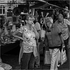Undecided (John Riper) Tags: johnriper street photography straatfotografie square vierkant bw black white zwartwit mono monochrome netherlands candid john riper rotterdam marine port worldportdays wereldhavendagen fuji fujifilm xt2 18135 stall market doubt undecided people woman plates