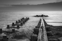 Sunset Over Holmes Jetty (Thomas Pohlig) Tags: seashore sea series seascape sand beach jersey jerseyshore jetty newjersey ocean oceanwaves rockpile rocks blackandwhite monochrome mono sunset