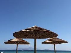 Shadow for the islands (Sven Bonorden) Tags: kos giali nisiros ageansea greece griechenland hellas strand beach sonnenschirm parasol stroh straw sea meer mittelmeer ägäis insel island summer sommer bluesky