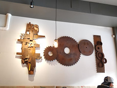 Wall decor at Gabriel's Gourmet Cafe (Ruth and Dave) Tags: customer gabrielsgourmetcafe cafe resturant nanaimo wall decor ornaments art saw circularsaw logging lumber industrial tools rusty artefacts sculpture