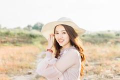 DSC_0182 (tungson.nguyen) Tags: girl woman vietnamese hat backlit dress film portrait sunshine grass