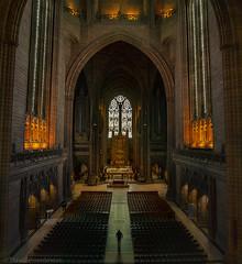 Walking Alone (beardmoredavid772) Tags: liverpool light cathedral walking people building religion